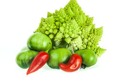 Romanesco broccoli, green tomatoes and red pepper. Cauliflower, tomatoes and red pepper for healthy eating and lifestyle Stock Photos