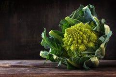 Romanesco broccoli or Roman cauliflower on a dark rustic wooden Stock Photography