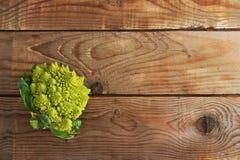 Romanesco broccoli, or Roman cauliflower on wooden background Royalty Free Stock Photography