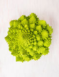 Romanesco cabbage head on white wooden Stock Images
