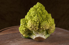 Romanesco cauliflower over wooden cutting board. Studio shot Royalty Free Stock Photo