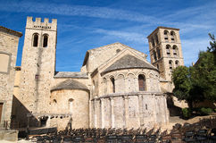 Romanesque apse. Apses and belfries of the church of Caunes-Minervois's Abbey with stage and chairs prepared for a concert royalty free stock image