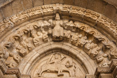 Romanesque Archivolts and tympanum. Detailed view of archivolts and tympanum in the  main entrance to Santiago church in Betanzos, La Coruña, Spain Royalty Free Stock Photos