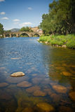 Romanesque bridge in Avila, Spain. Old Romanesque bridge in El barco de Avila, county of Spain. Behind you can see the castle and in front of there is the Tormes Royalty Free Stock Image