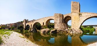 Romanesque bridge over the Fluvia river in Besalu Stock Photos