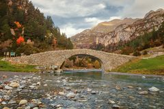 Romanesque bridge in the valley of Bujaruelo, XIII century on th. E Ara river, in the Aragonese Pyrenees, bordering the National Park of Ordesa and Monte Perdido Royalty Free Stock Photography