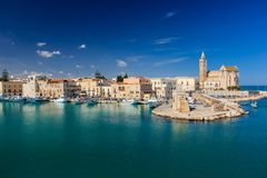 The Cathedral and seafront. Trani. Apulia. Italy. The romanesque cathedral of saint Nicholas and the seafront. Trani. Apulia. Italy royalty free stock photos