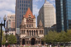 Romanesque church. Tourists visiting Trinity church Boston, Mass. The church made of granite and red sandstones, the low part based on Romanesque architecture stock photos