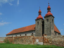 Romanesque church. Church built in about X century, Poland, countryside. The building attached to it is newer. The fence hides a small cemetary Stock Photos