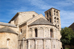 Romanesque church of Caunes-Minervois. Apse and church steeples of the Abbey of Caunes-Minervois Stock Photography