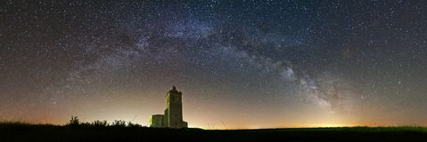 Romanesque church under milky way complete arch pointing the way of St James in Palencia royalty free stock photos