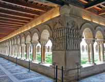 Romanesque cloister. Panoramic Romanesque cloister of the monastery of Santo Domingo de Silos backlit province of Burgos in Spain Stock Photo