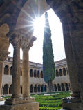 Romanesque cloister. Of the monastery of Santo Domingo de Silos backlit in the province of Burgos in Spain Stock Photography