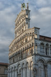 Romanesque facade of the San Michele in Foro, a Roman Catholic church in Lucca, Tuscany. 13th century Romanesque facade of the San Michele in Foro, a Roman Stock Photo