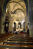 Romanesque medieval church in Mazan. MAZAN, FRANCE – JUL 19, 2014: Church service at the church in Mazan. Mazan is a town of 4500 inhabitants, with the royalty free stock photo
