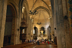 Romanesque medieval church in Mazan, France. MAZAN, FRANCE – JUL 19, 2014: Church service at the church in Mazan. Mazan is a town of 4500 inhabitants royalty free stock images