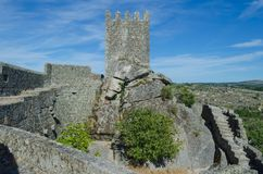 Tower and wall of the castle of Sortelha. Portugal. Romanesque style medieval castle in the Sabugal municipality. Distrito de Guarda, As Beiras Region. Portugal royalty free stock photos