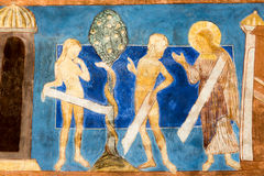 Romanesque wall painting. The Fall of Adam and Eve at the Tree o. The Fall of Adam and Eve at the Tree of Knowledge. Romanesque wall painting in Bjaresjo churh royalty free stock images