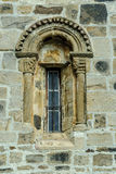 Romanesque window. Sight of a window of the Romanesque collegiate church of San Salvador in Cantamuda in Palencia, Castile and León, Spain Stock Photography
