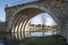 Romanesque Zamora stone bridge arc. Medieval bridge city romanesque Zamora arc Stone. Blue skye and grass Royalty Free Stock Image