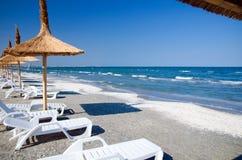 Romania - Black Sea. Umbrella and sunbeds at the Black Sea in Mamaia, Romania stock photography
