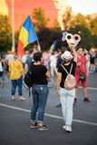 Romania, Bucharest - August 11, 2018: Protester girls displaying centenary icon as handcuffs Royalty Free Stock Photo