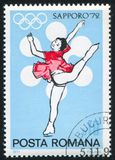 Skater. ROMANIA - CIRCA 1971: stamp printed by Romania, shows figure skater from winter olympics in Sapporo, circa 1971 royalty free stock image
