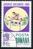 Hurdling. ROMANIA - CIRCA 1964: stamp printed by Romania, shows Hurdling, circa 1964 Royalty Free Stock Photography