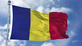 Romania Flag in a Blue Sky. Use this clip loud and proud to express loyalty and love to our country. It is a seamless loop with luma channel Stock Photo