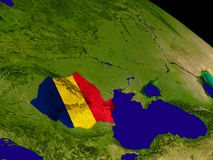 Romania with flag on Earth Stock Photo