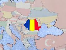 Romania with flag on globe Stock Photo