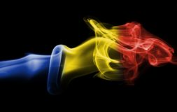 Romania flag smoke. On a black background Royalty Free Stock Photography