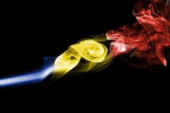 Romania flag smoke. On a black background Stock Photos