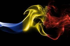 Romania flag smoke. Isolated on a black background Stock Image