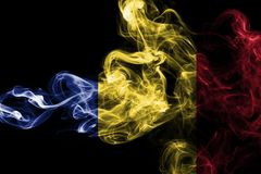 Romania flag smoke isolated on a black background. Romania flag smoke isolated on a black background Royalty Free Stock Photography