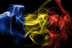 Romania flag smoke. Isolated on a black background Royalty Free Stock Images