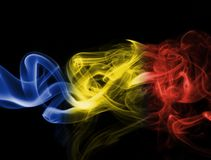 Romania flag smoke. Isolated on black background Royalty Free Stock Images