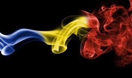Romania flag smoke. Isolated on a black background Stock Photography