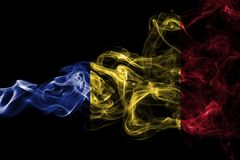 Romania flag smoke. Isolated on a black background Stock Photos