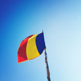 Romania flag. Waving over blue sky Stock Photo