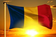 Romania flag weaving on the beautiful orange sunset with clouds background. Romania flag weaving on the beautiful orange sunset background stock images