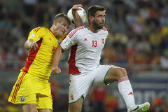 Romania - Hungary football game. Dániel Böde (right, Hungary) and Dorin Goian (left, Romania) pictured during Romania - Hungary FIFA World Cup qualifier Stock Photography