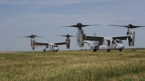 Romania, May 2015, US Marines Two MV 22B Osprey. US Marines. Two MV 22B Osprey aircraft roll over a airfield at a airbase stock video