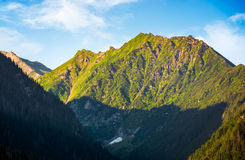 Romania mountain ridge at sunrise. Blue sky with clouds Royalty Free Stock Photos