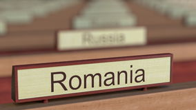 Romania name sign among different countries plaques at international organization. 3D rendering Stock Image