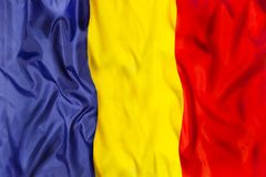 Romania national flag with waving fabric. Romania country independent state national flag banner close-up with waving fabric texture Stock Photos