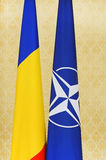 Romania and NATO flags Royalty Free Stock Images