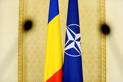 Romania and NATO flags Royalty Free Stock Photo