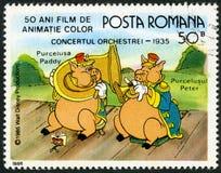 ROMANIA-1986 : paddy d'expositions et Peter, caractères de Walt Disney dans la bande Concert, 1935, consacré cinquante ans de film Photographie stock libre de droits