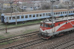 Romania passanger trains. Bucharest, Romania, March 13, 2016: Passenger trains are seen the switch yard of Gara de Nord main railway station Royalty Free Stock Images